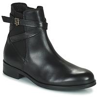 Schoenen Dames Laarzen Tommy Hilfiger TH HARDWARE ON BELT FLAT BOOT Zwart