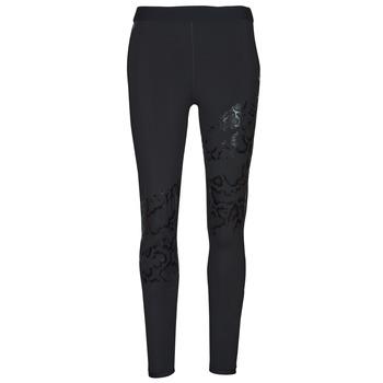 Textiel Dames Leggings Puma UNTAMED PRINT TIGHT Zwart